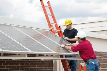 Builders On a Solar Panel Installation Project